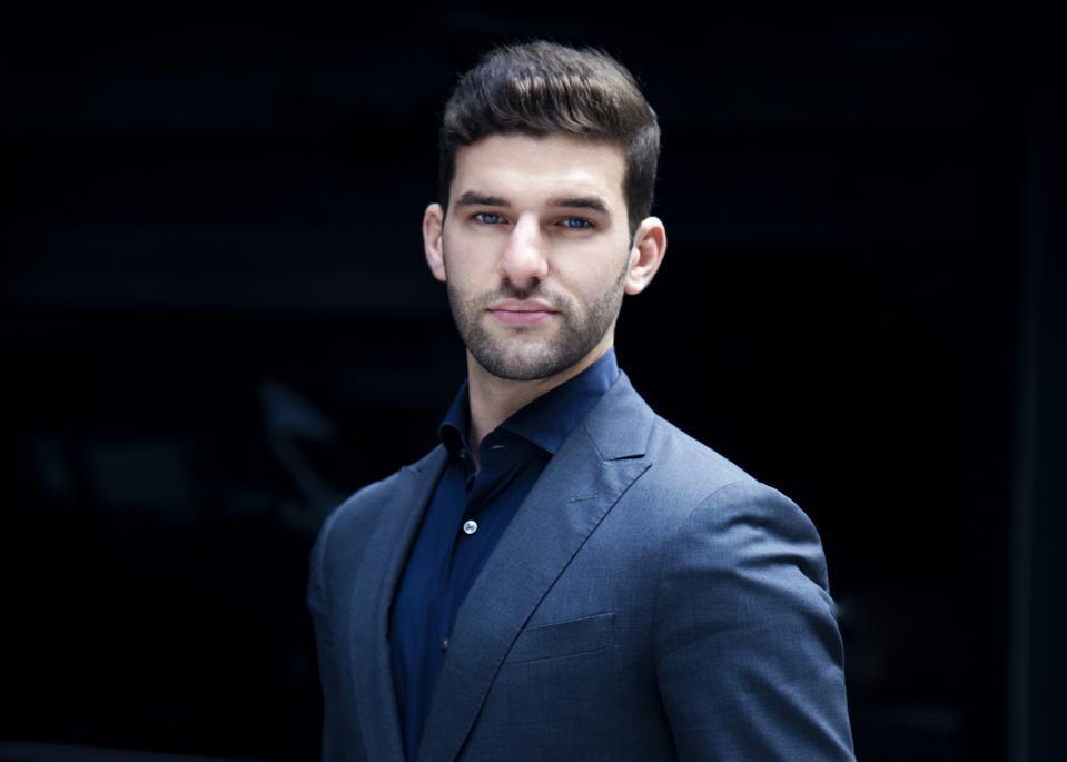 A man in a blue suit