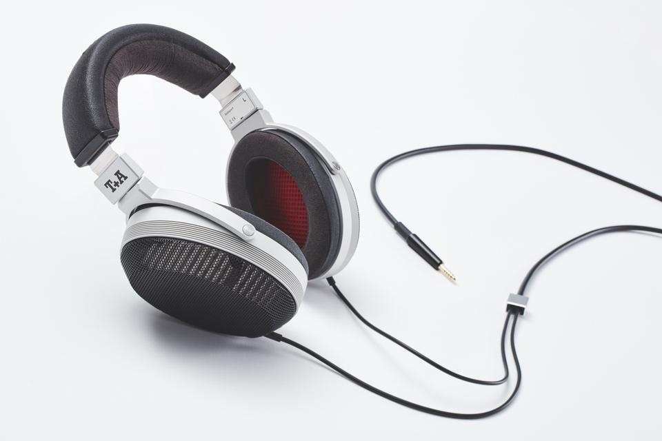 A pair of T+A Solitaire P headphoens with cables attached.