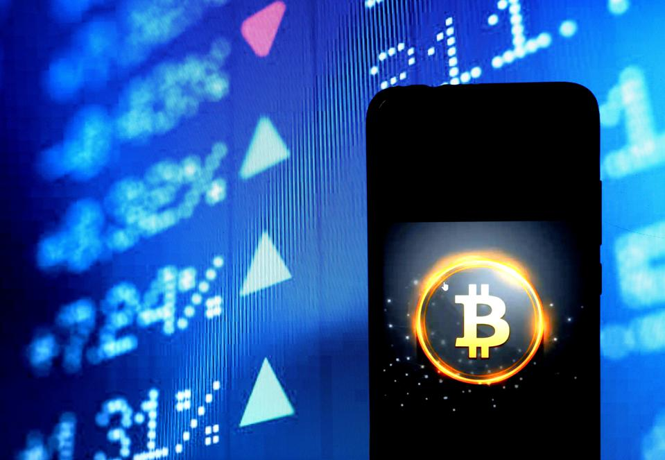 In this photo illustration a Bitcoin cryptocurrency logo...