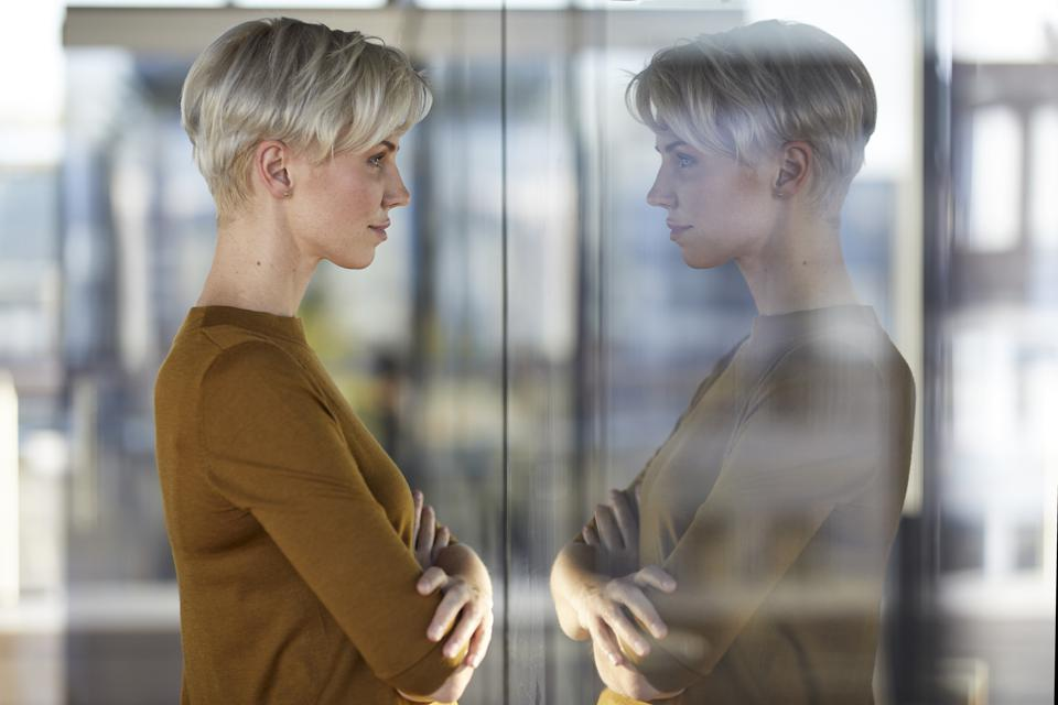 Woman reflected in window