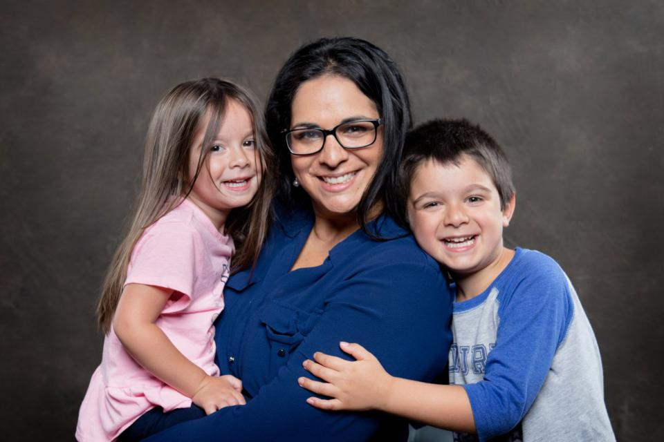 Gayatri Agnew, creator of Mother's Monday movement, pictured with her two children