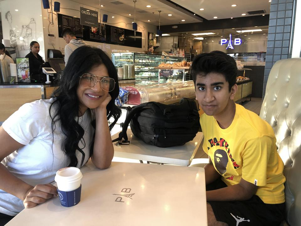 Alexandra and Krish Mysoor sit at a table in a cafe.