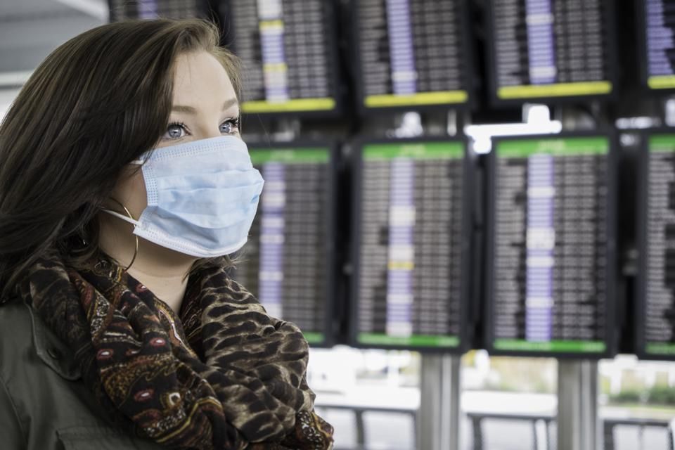 Fearful Passenger Wears Mask at the Airport