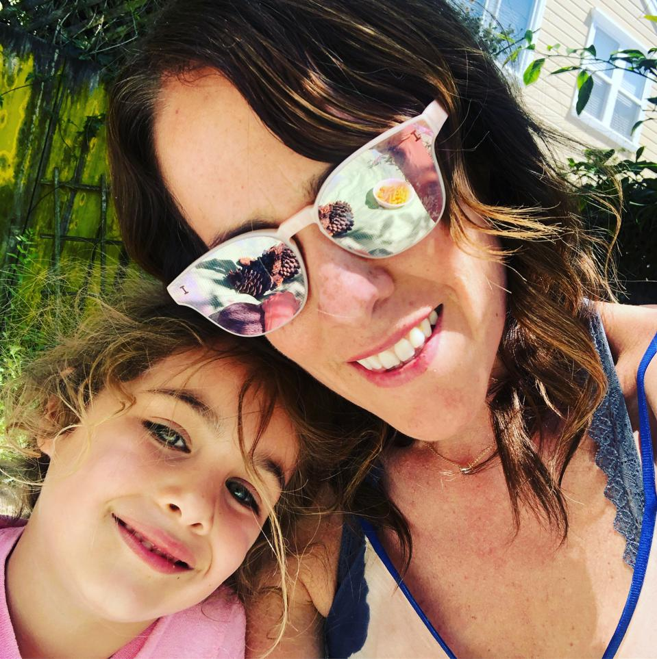 Nice photo of Kelly with her daughter. Kelly in mirror sunglasses