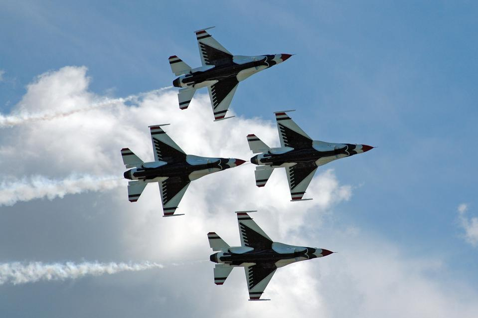 The undersides of the Thunderbirds' F-16s look like flying birds in a diamond formation over the skies of Niagara Falls.