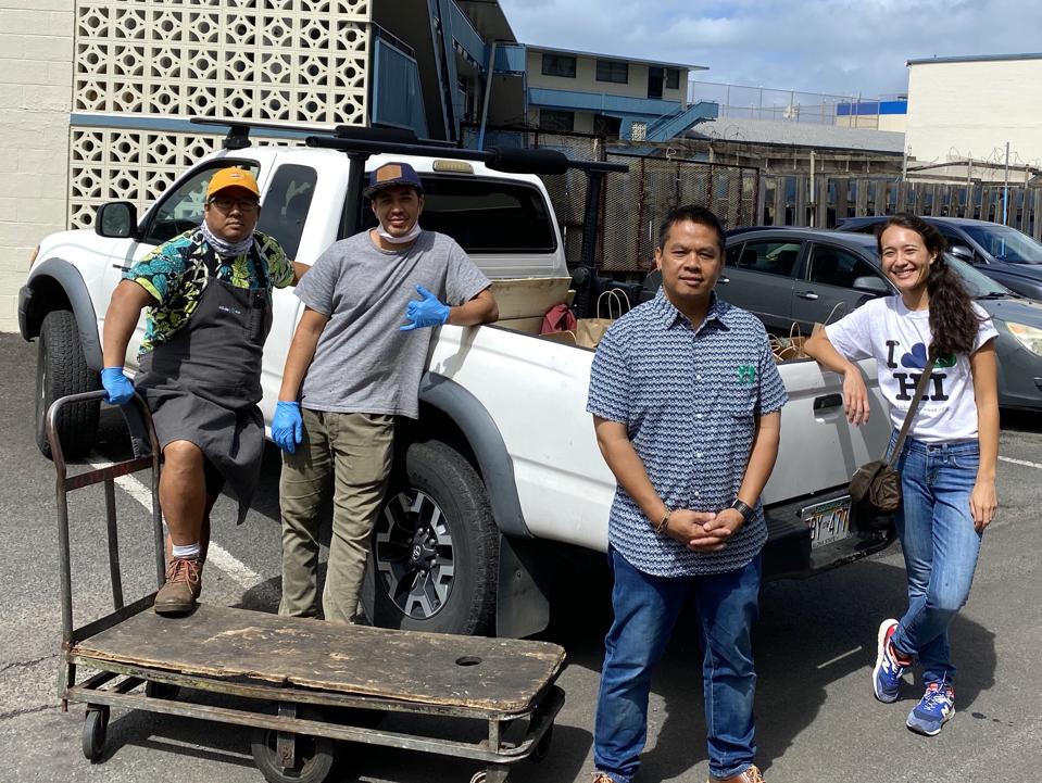 (left to right) Mark ″Gooch″ Noguchi, Sonny Ganadan from KVibe, Executive Director for Aloha Harvest Phil Acosta, and Aloha Harvest Community Resource Coordinator Leslie Pyo