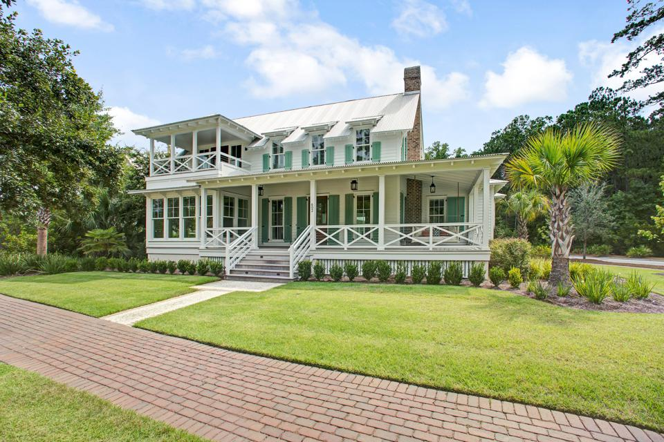 This five-bedroom, five-and-a-half bathroom residence at 602 Old Moreland Road in Palmetto Bluff's Moreland Village features beautiful views of Lake Bales.