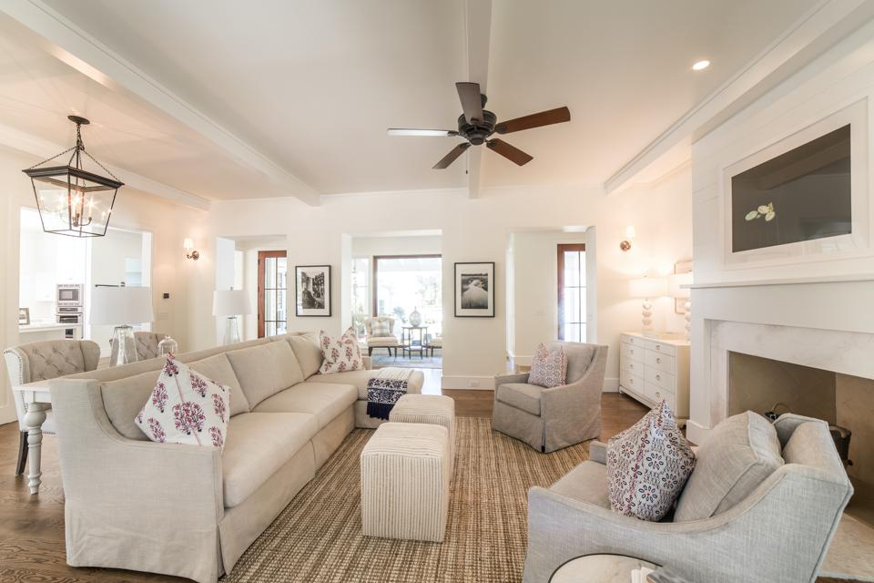 Listed at $2,395,000, the 4,436-square-foot home located features an open concept living space, a dining room and downstairs master suite with white oak hardwood floors throughout.