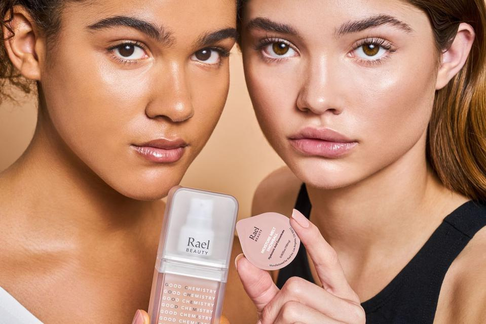 Models with Rael self-care beauty products.