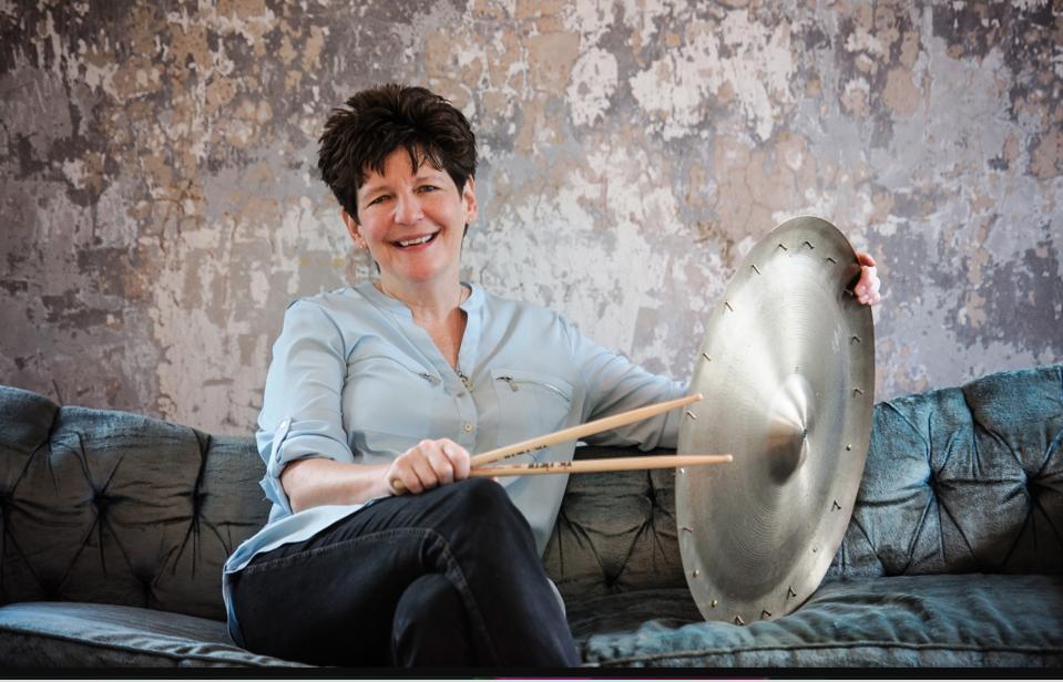 Sherrie Manicle, leader of The DIVA Jazz Orchestra sits wih her drunsticks