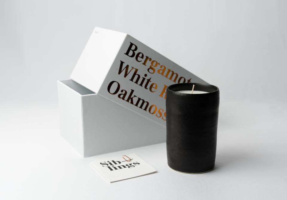 A Siblings candle with Bergamot, White Rose and Oakmoss.