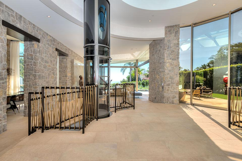 Glass elevator with views in luxury LA home