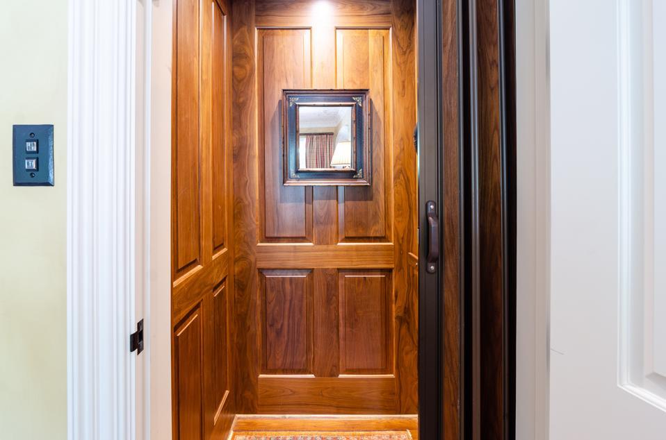 Wood-paneled elevator