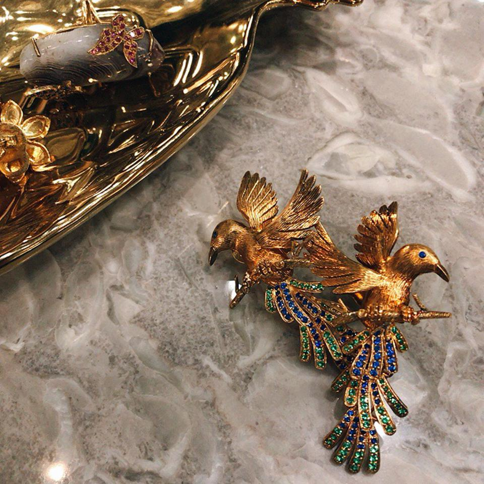 Winged creatures earrings with emeralds and blue sapphires by Tim Tam Ong