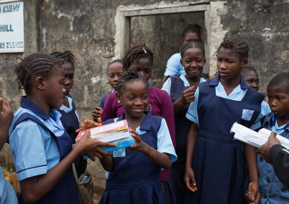Students at Sahuna Royal Mountain Academy Primary School in Freetown, Sierra Leone, were among the 1.8 million students to receive free UNICEF school kits in May 2015 — in the middle of the worst Ebola outbreak in history.