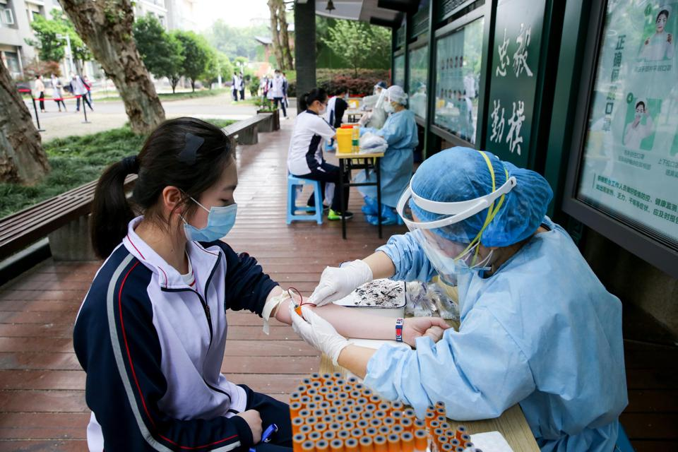 Students Receive Nucleic Acid And Serum Antibody Tests In Wuhan