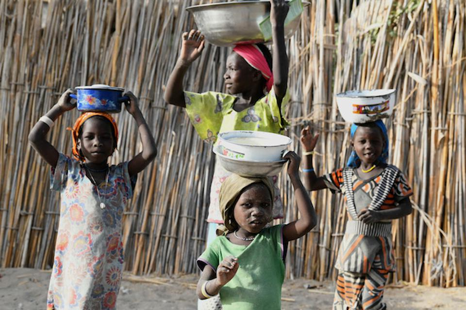 Children carry food in Bol, Chad, one of more than 190 countries and territories where UNICEF works to save and protect vulnerable children.