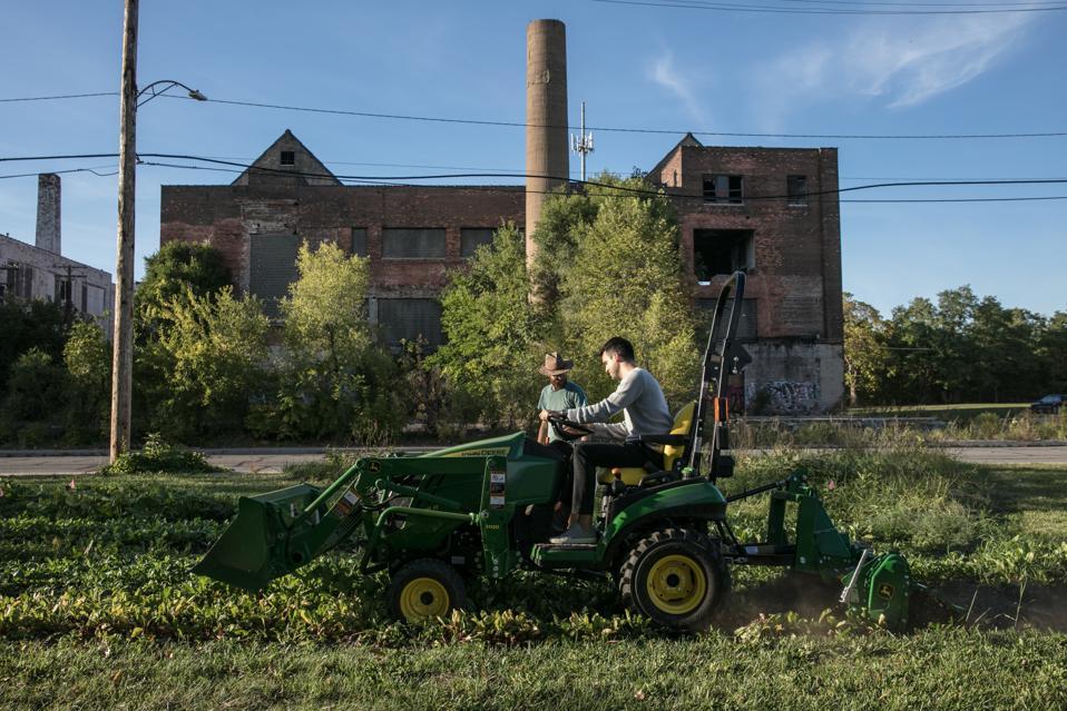 Dan Miller riding a tractor in Detroit.