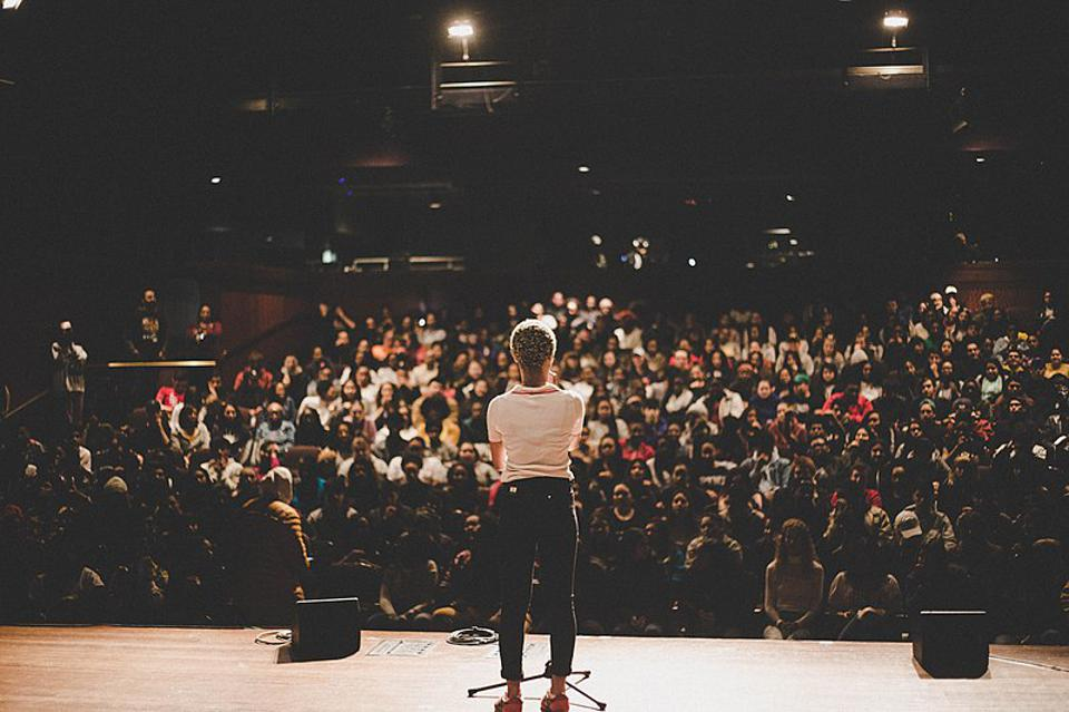 A person standing in front of a large audience