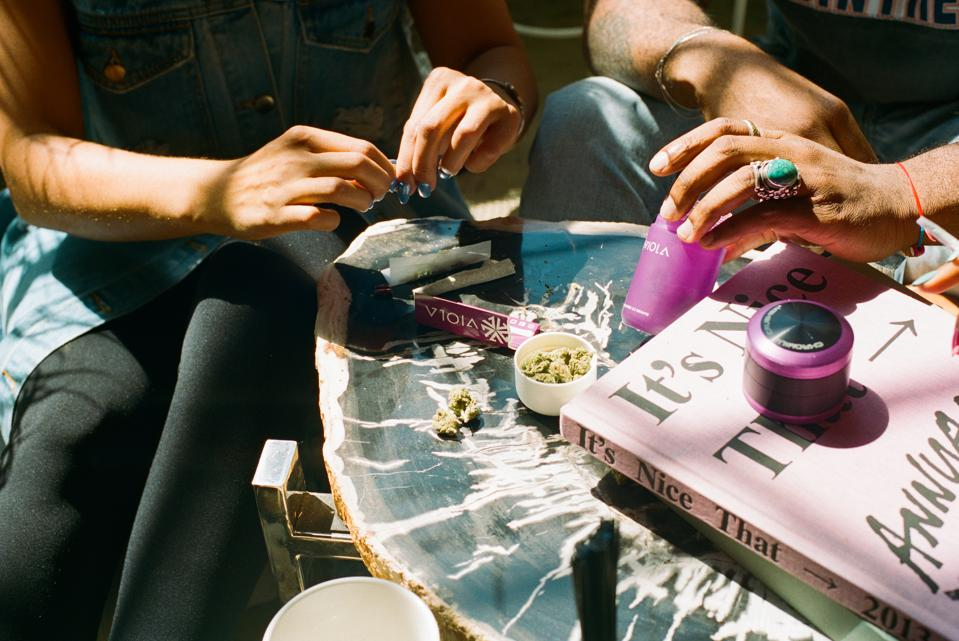 Viola Lifestyle Shot of rolling some j's.