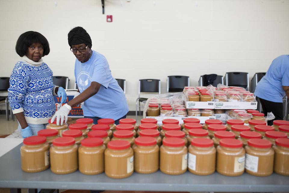 Two African-American women helping at a food bank