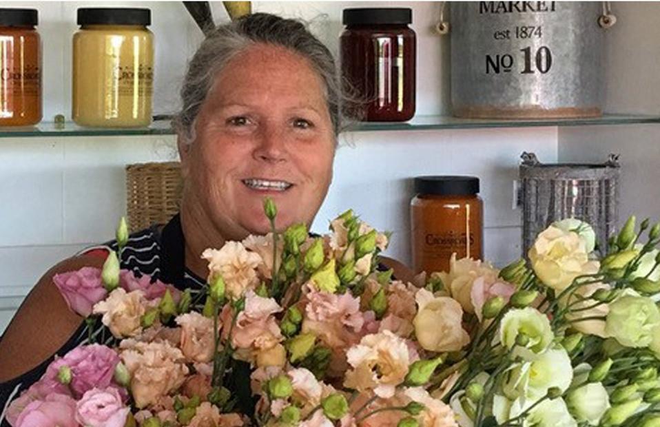 Teresa Brown holding flowers
