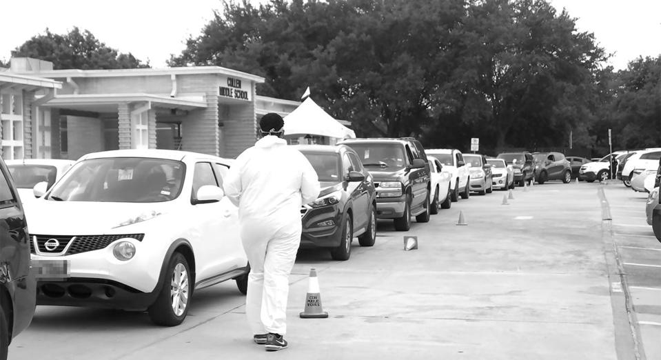 Cars lined up at a #IDIDMYPART testing site.
