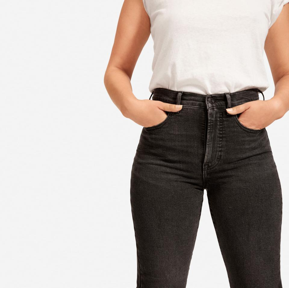 A closeup of womens jeans in black