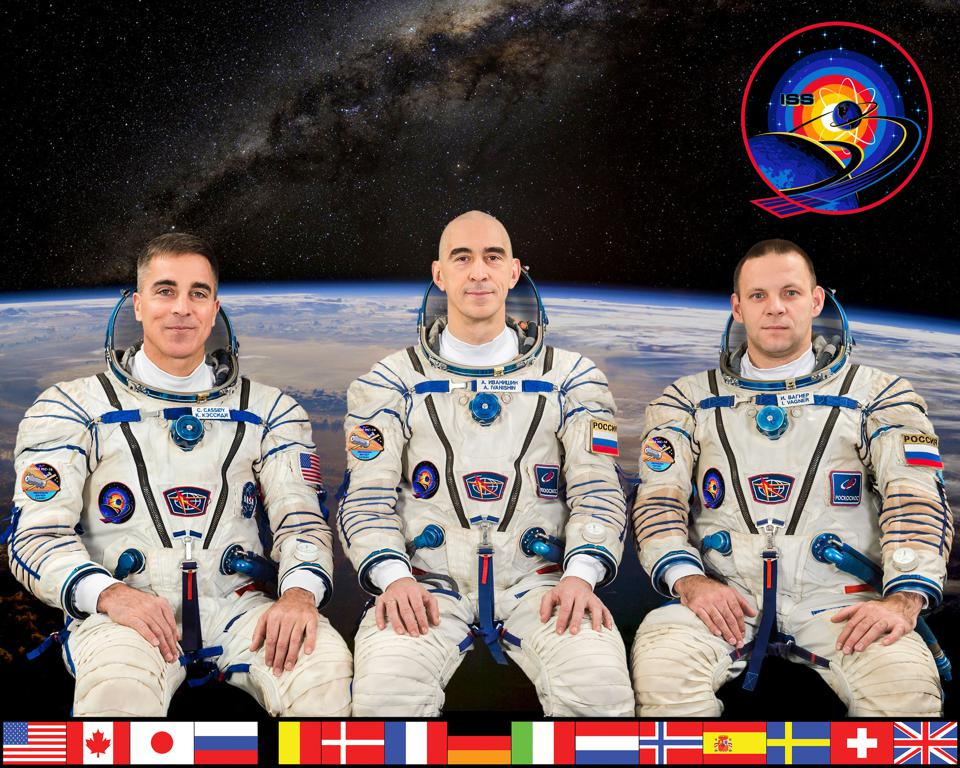 A portrait of the crew of Expedition 63 on the INternational Space Station.