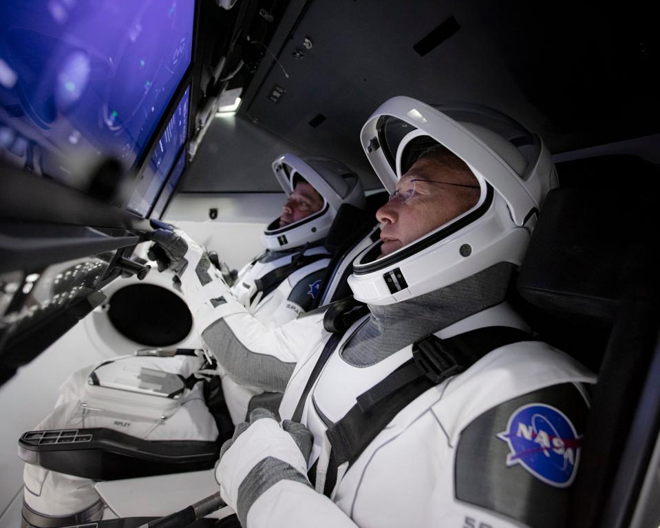 The crew of the Demo-2 mission in SpaceX' Crew Dragon spacecraft.