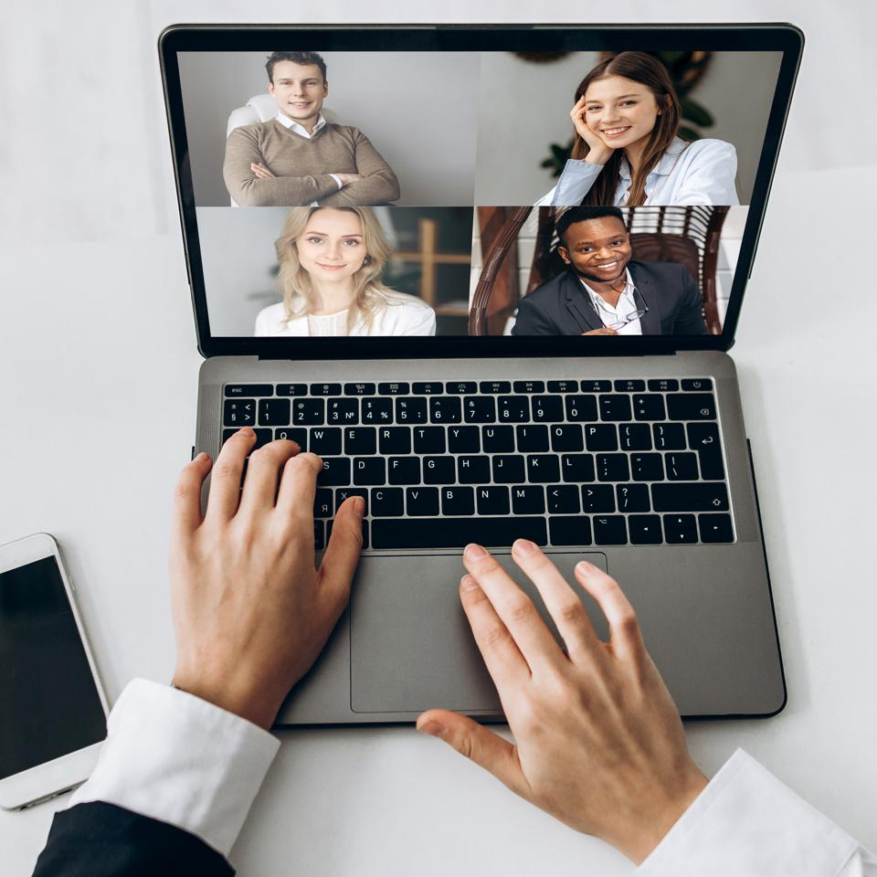 A virtual work meeting with five professionals