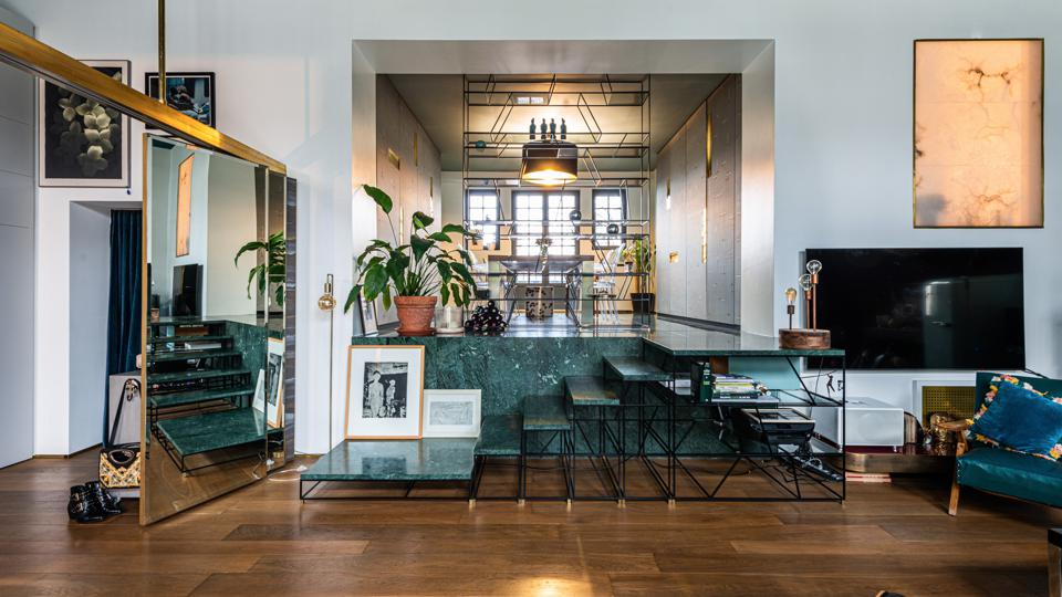 The raised dining room is accessed by an elegant set of steps