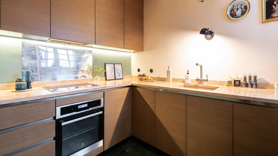 The separate kitchen has modern wooden furniture