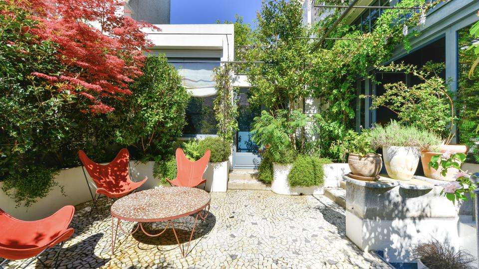 The terrace has been landscaped by designer Camille Muller