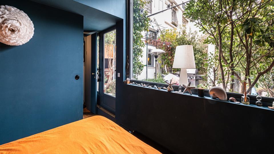 The vast window in this bedroom looks onto the terrace
