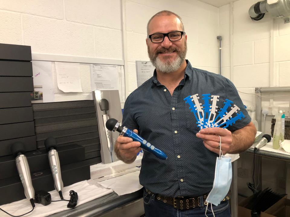 Andrew Crichton holding the medical accessories manufactured in his factory
