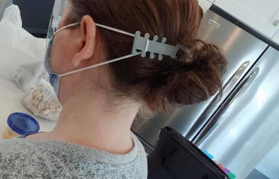 A woman wearing a medical mask and modelling the ear savers