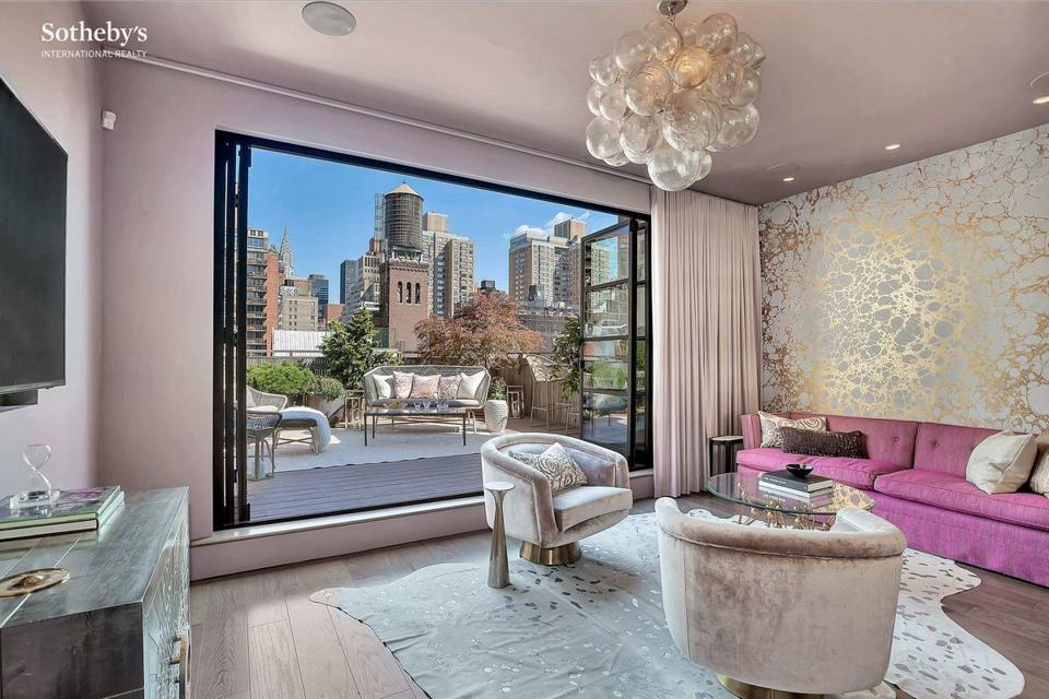 The living room in a New York penthouse that opens onto a terrace where the seller took $680,000 off the contract price to close.