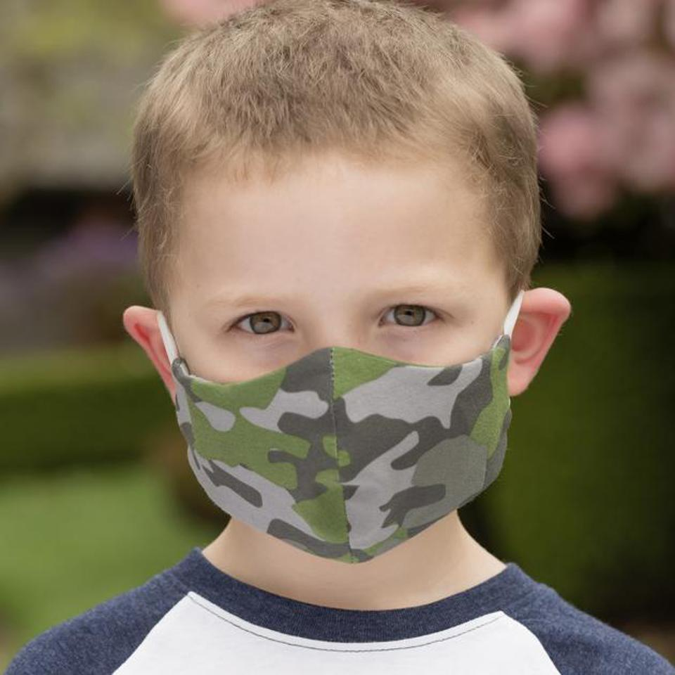 A young boy wearing a BooginHead camo print face mask