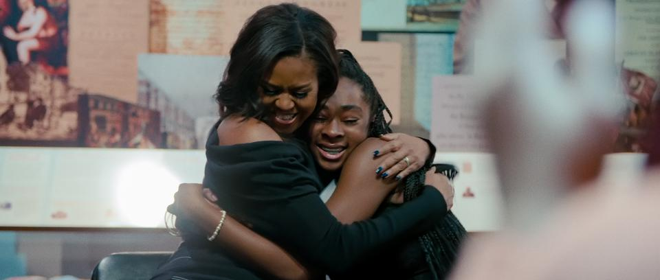 Former First Lady Michelle Obama embraces student in her new Netflix documentary, ″Becoming.″