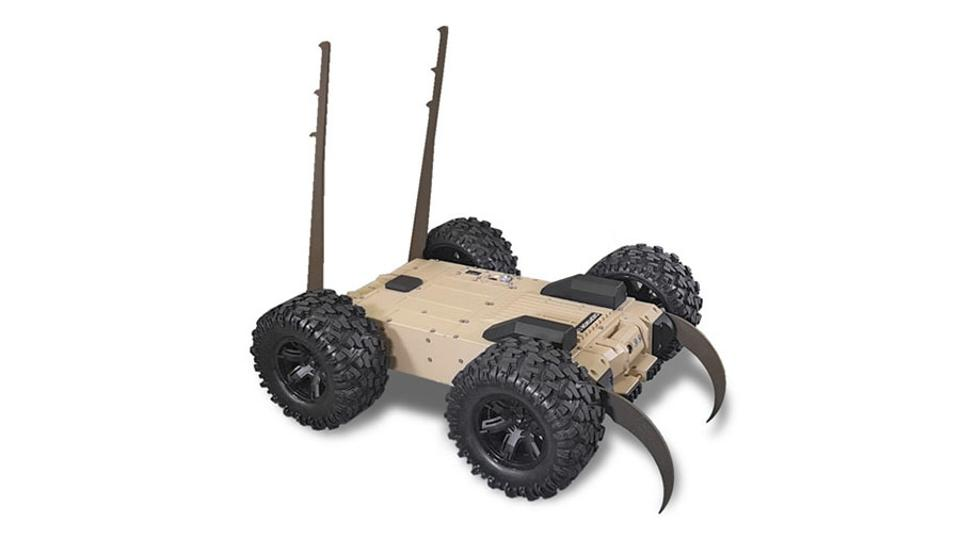 A four-wheeled robot with what looks like hooks on the front and spikes at the back.