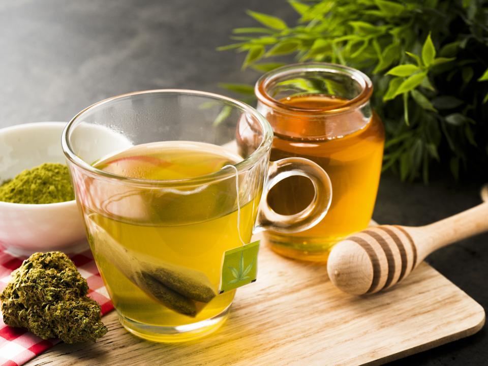 a steaming cup of cannabis tea