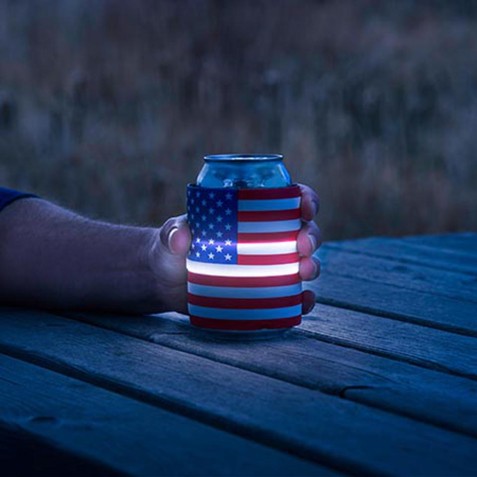 Light up the night with this LED insulated drink wrap by Nite Ize. Simply slap to wrap and turn the LED on, off, or set to flash with the push of a button. Available in three colors, as well as USA (shown) and Colorado flag options.
