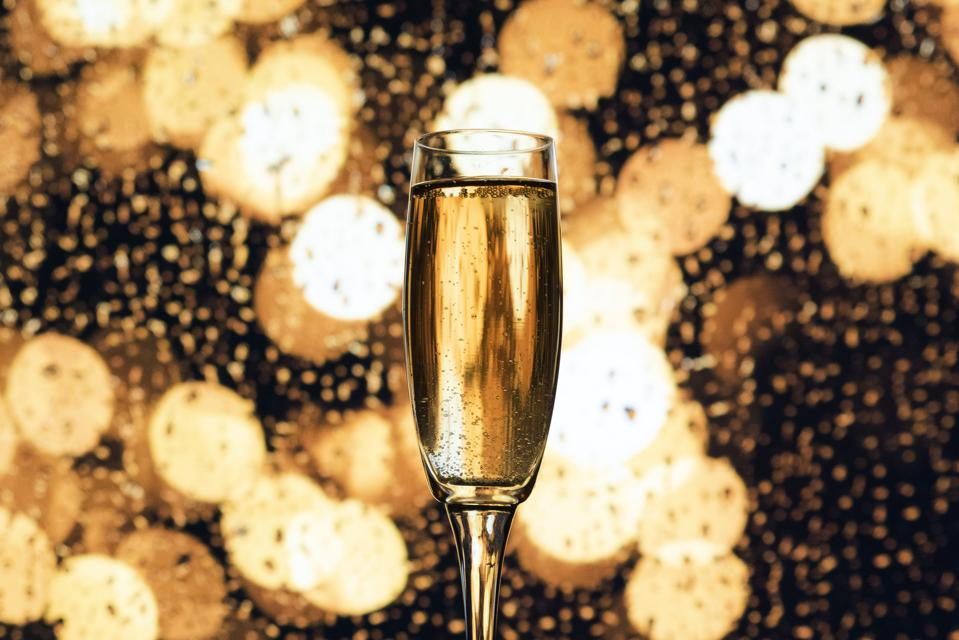 A glass of champagne–much less in demand at present