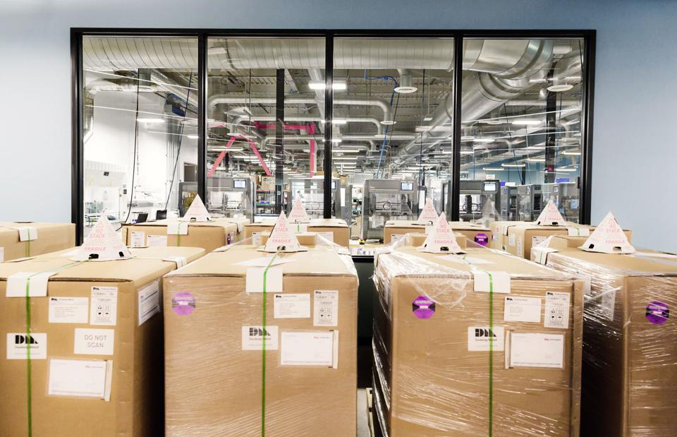 Metal 3-D printers in boxes ready to ship