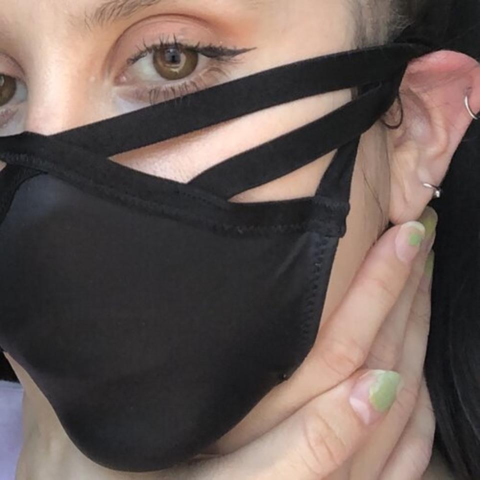 The artist wears her panty respirator.