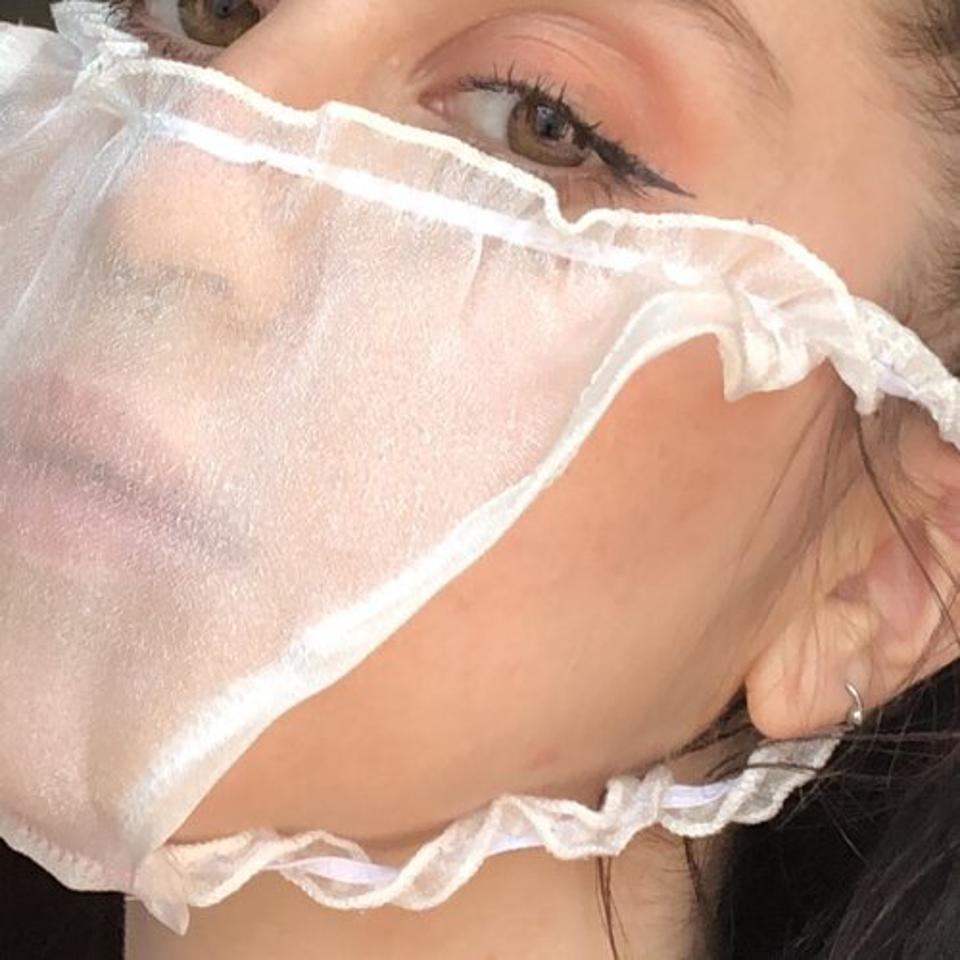 Hannah Bates wears a pair of see-through panties she's turned into a COVID-19 mask.