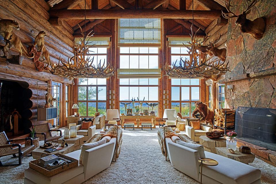 The expansive Great Room features a soaring double-sided moss rock fireplace and expansive views.