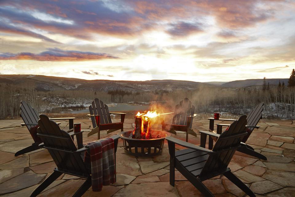 A stone patio overlooks three of the lakes on the property. It is a perfect spot for viewing breathtaking sunsets and the surrounding aspen forests.
