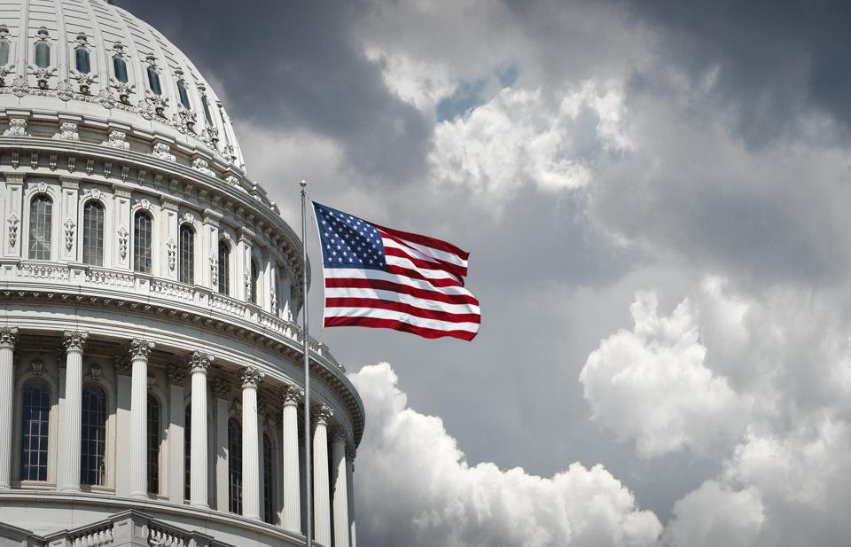 US Capitol and waving american flag